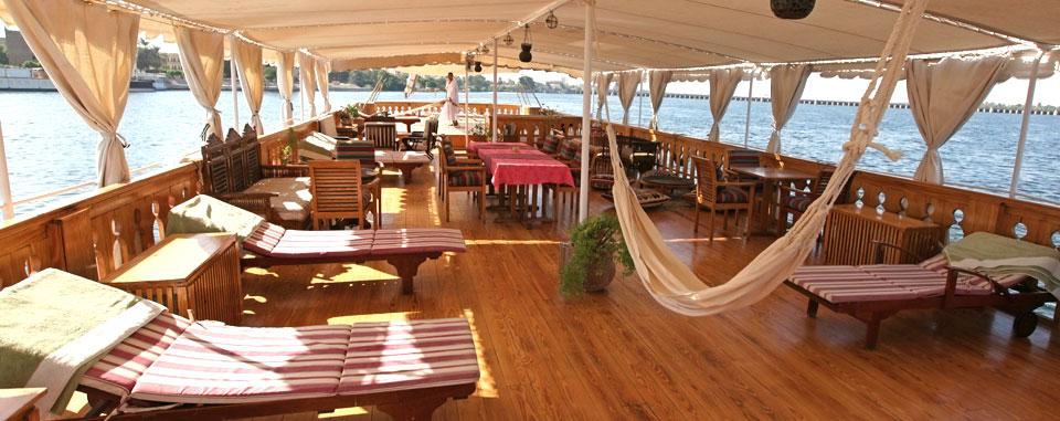 The half-covered sun deck forms the heart of the Dahabiya